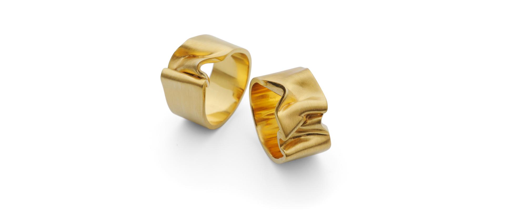 Brushed gold ribbon ring alternative wedding band